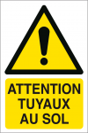 Attention tuyaux au sol